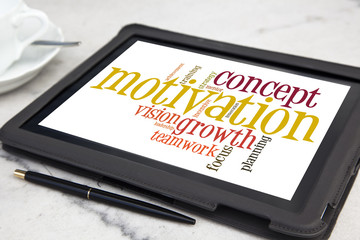 tablet with concept motivation word cloud