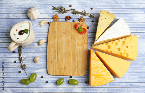 Different Italian cheese on wooden table