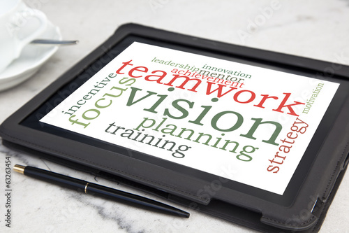 Tablet with teamwork vision word cloud