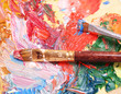 Paints, brush and art palette close-up