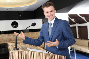 Businessman is making speech at conference room