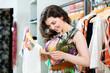 Young woman shopping in fashion store