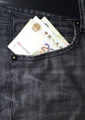 money bank note in pocket money jeans background