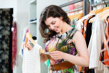Young woman shopping in fashion store