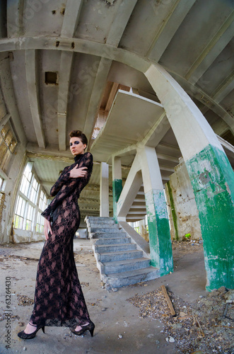 Beautiful fashion model posing in abandoned building