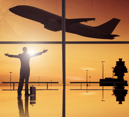 Silhouettes Of Businessan and Airplane In Airport