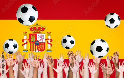 Raised Arms and Spanish Flag as a Background for World Cup