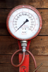 An old tire-pressure measuring gauge