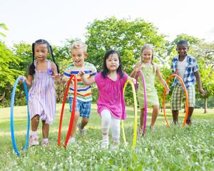 Children Hula Hooping Outdoors