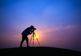 Silhouette of Photographer on Hill Top