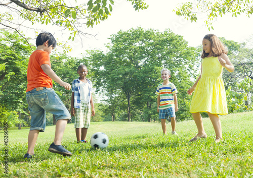 Children Playing Football Outdoors
