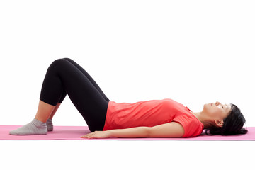 Woman laying down for starting exercise