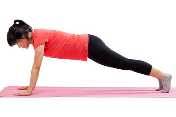 Woman exercising with push up pose