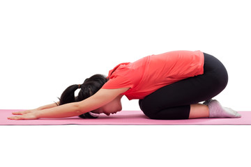 Woman doing yoga child pose