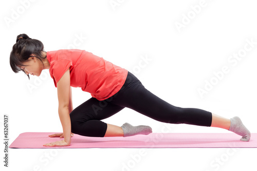 Woman exercising isolated