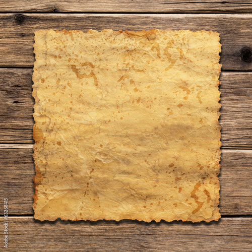 a sheet of vintage paper on wooden background