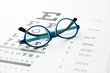 Glasses on eye chart - 63269262