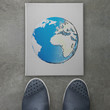 hand drawn  abstract globe on front of business man feet as conc