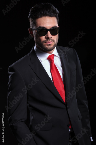 serious business man looks into camera
