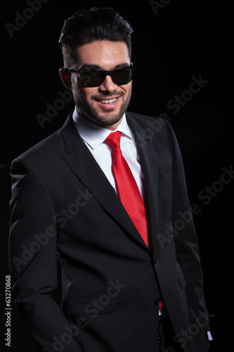 happy business man smiles for you