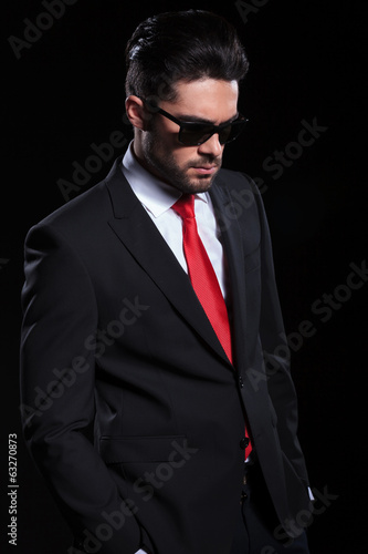 sad business man looks down