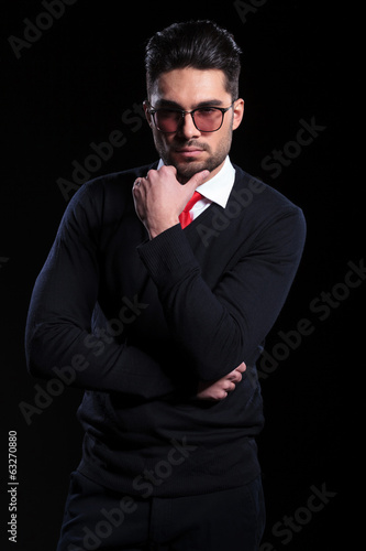 business man looks pensively at you