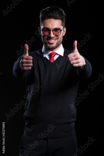 business man shows both thumbs up