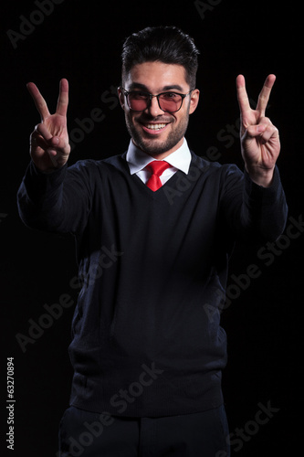 business man shows victory with both hands