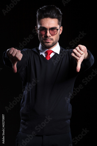 business man shows both thumbs down