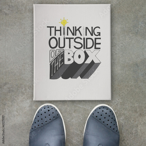 design word THINKING OUTSIDE OF THE BOX  on canvas board on fro