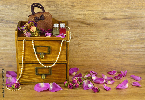 Wooden box with rose petals