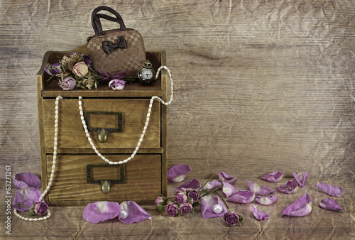 Wooden box with rose petals textured