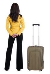 traveling young woman with  suitcas  in yellow suit looking at w