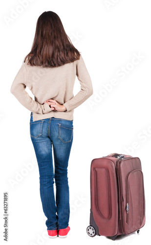 back view of standing young beautiful  brunette woman.