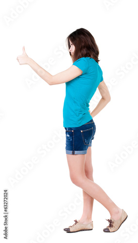 Back view of  woman thumbs up.