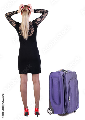 Back view of shocked business woman in dress traveling with suit