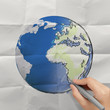 hand drawing abstract globe on crumpled paper as concept