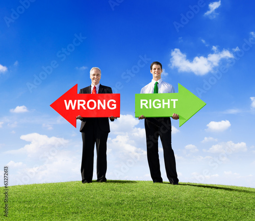 Two Businessmen Holding Contrasting Arrows for Wrong and Right