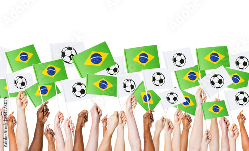 canvas print picture Raised Arms Holding Brazilian Flag and Banners