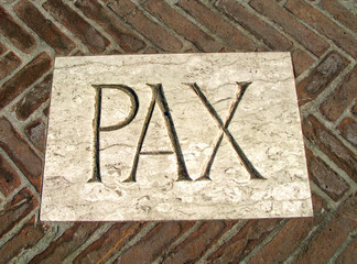 huge inscription PAX as a symbol of peace on a plaque