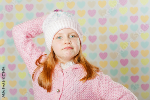 The little girl in a pink hat and a sweater