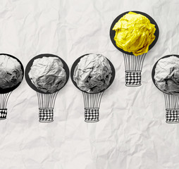 hand drawn air balloons with crumpled paper ball as leadership c