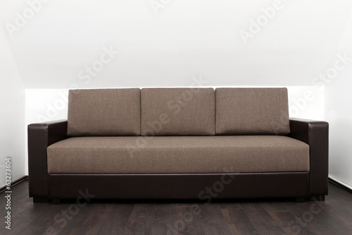 brown couch in bright white interior