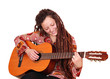 girl with dreadlocks hair play guitar