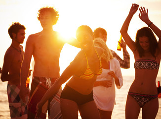 Young People Enjoying a Summer Beach Party