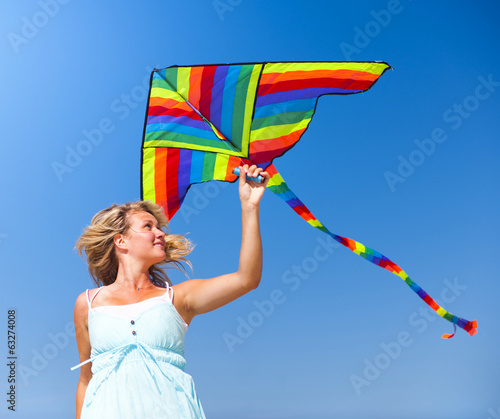 Young Woman Playing With a Kite Outdoors