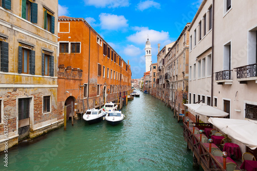 Venice cityscape, narrow water canal and traditional buildings.