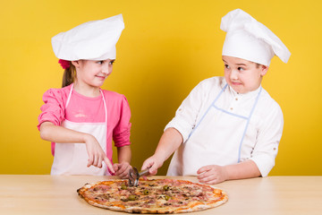 Cheerful children cook pizza