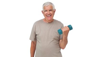 Portrait of a happy senior man exercising with dumbbell