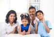 happy indian family indoor portrait
